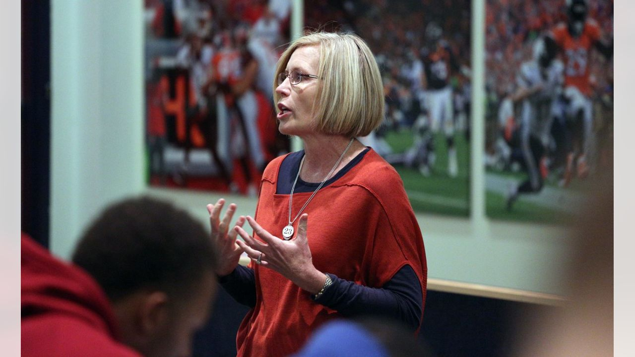 Vice President of Community Development Cindy Kellogg speaks to the team about the Walter Payton NFL Man of the Year award, which was given to tight end Virgil Green.