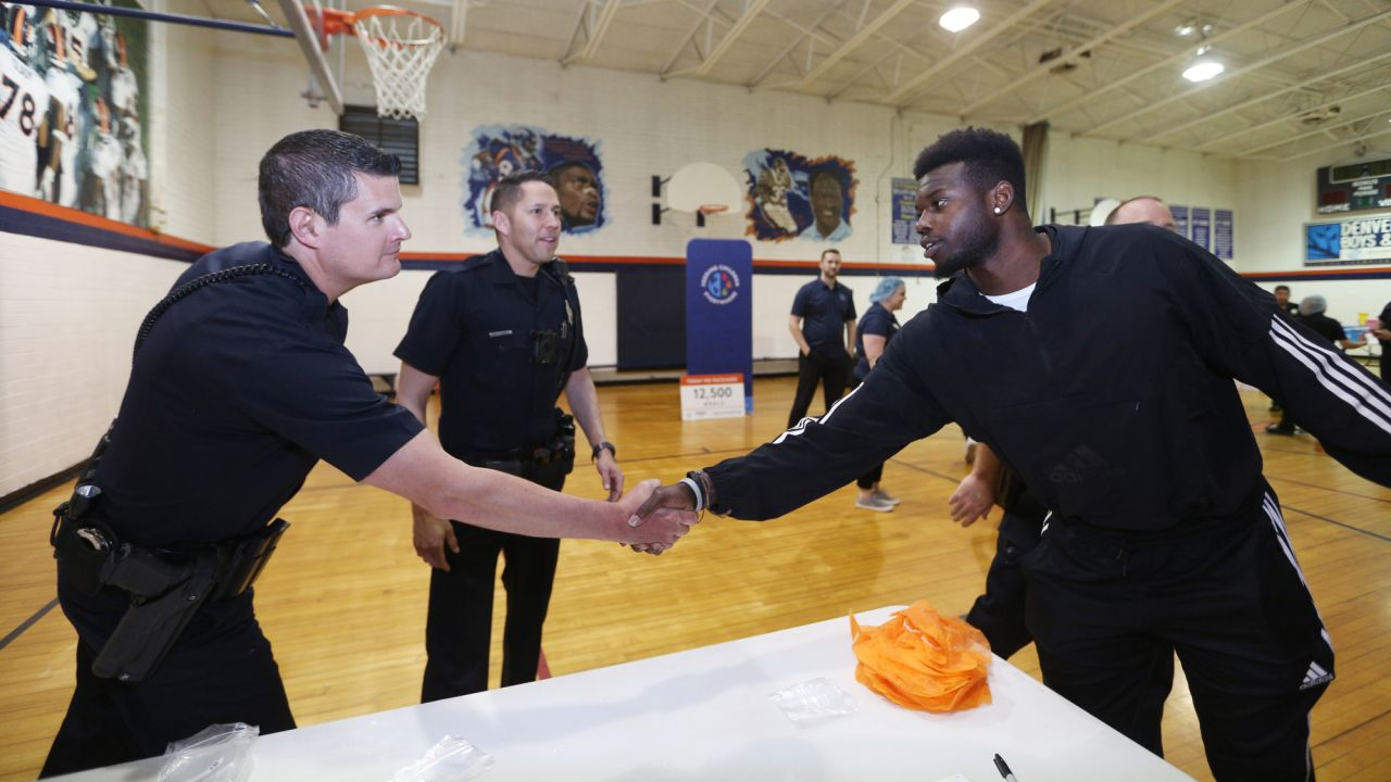 Fred Brown during a meal-packaging event with Feeding Children Everywhere at the Denver Broncos Boys & Girls Club on May 14, 2019, with volunteers from the Broncos, the Denver Police Department and the club.