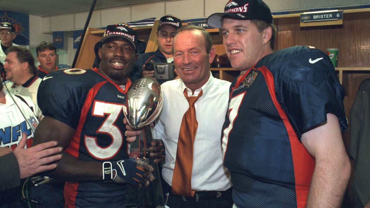 Terrell Davis, Pat Bowlen, and John Elway share the glory of their Super Bowl victory against the Green Bay Packers at Qualcomm Stadium in San Diego, CA on January 25, 1998.