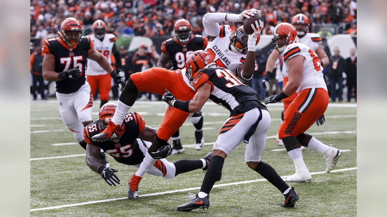 Cleveland Browns tight end David Njoku, center, leaps into the arms of Cincinnati Bengals free safety Jessie Bates (30) on a touchdown run in the first half of an NFL football game, Sunday, Nov. 25, 2018, in Cincinnati. (AP Photo/Gary Landers)