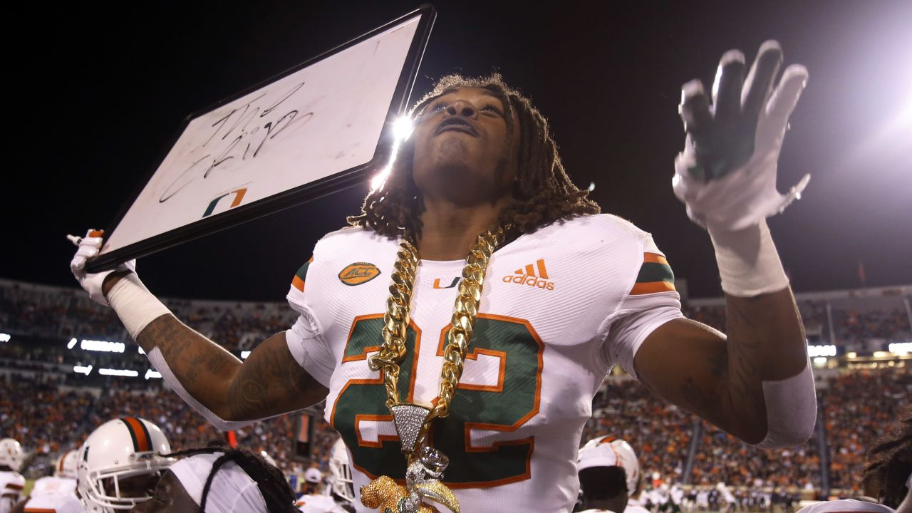 Miami defensive back Sheldrick Redwine (22) celebrates an interception against Virginia during the first half of an NCAA college football game in Charlottesville, Va., Saturday, Oct. 13, 2018. (AP Photo/Steve Helber)