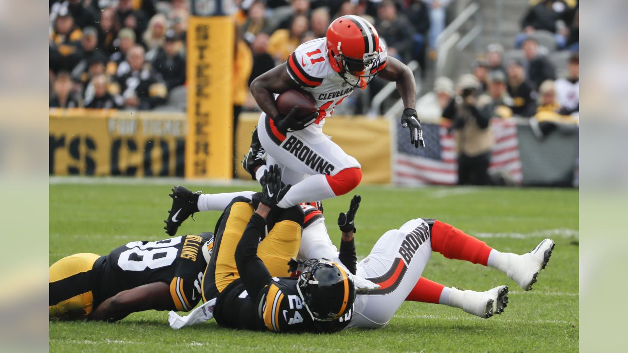 Cleveland Browns wide receiver Antonio Callaway (11) runs the ball as Pittsburgh Steelers linebacker Vince Williams, left, and cornerback Coty Sensabaugh (24) defend in the first quarter of an NFL football game, Sunday, Oct. 28, 2018, in Pittsburgh. (AP Photo/Gene J. Puskar)