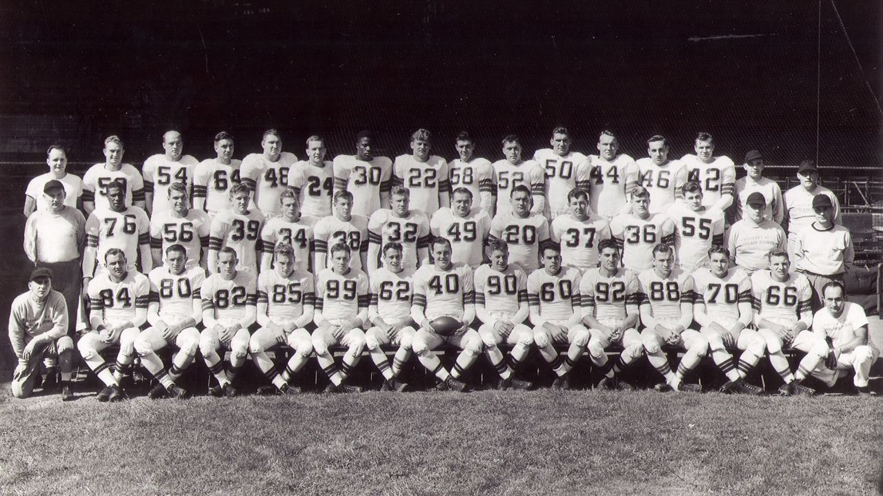 The 1946 Browns entered the brand-new All-America Football Conference with white uniforms, featuring white helmets, brown and orange stripes on the sleeves and socks, and brown block numbers with an orange drop shadow. The Browns wouldn't wear a drop shadow on their uniforms again until 2002.
