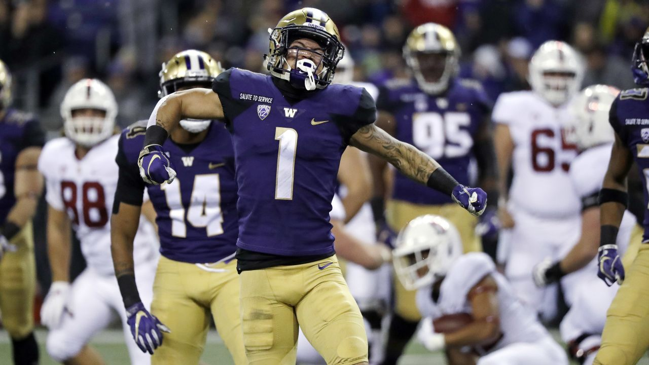 Washington's Byron Murphy reacts after a stop against Stanford in the first half of an NCAA college football game Saturday, Nov. 3, 2018, in Seattle. (AP Photo/Elaine Thompson)