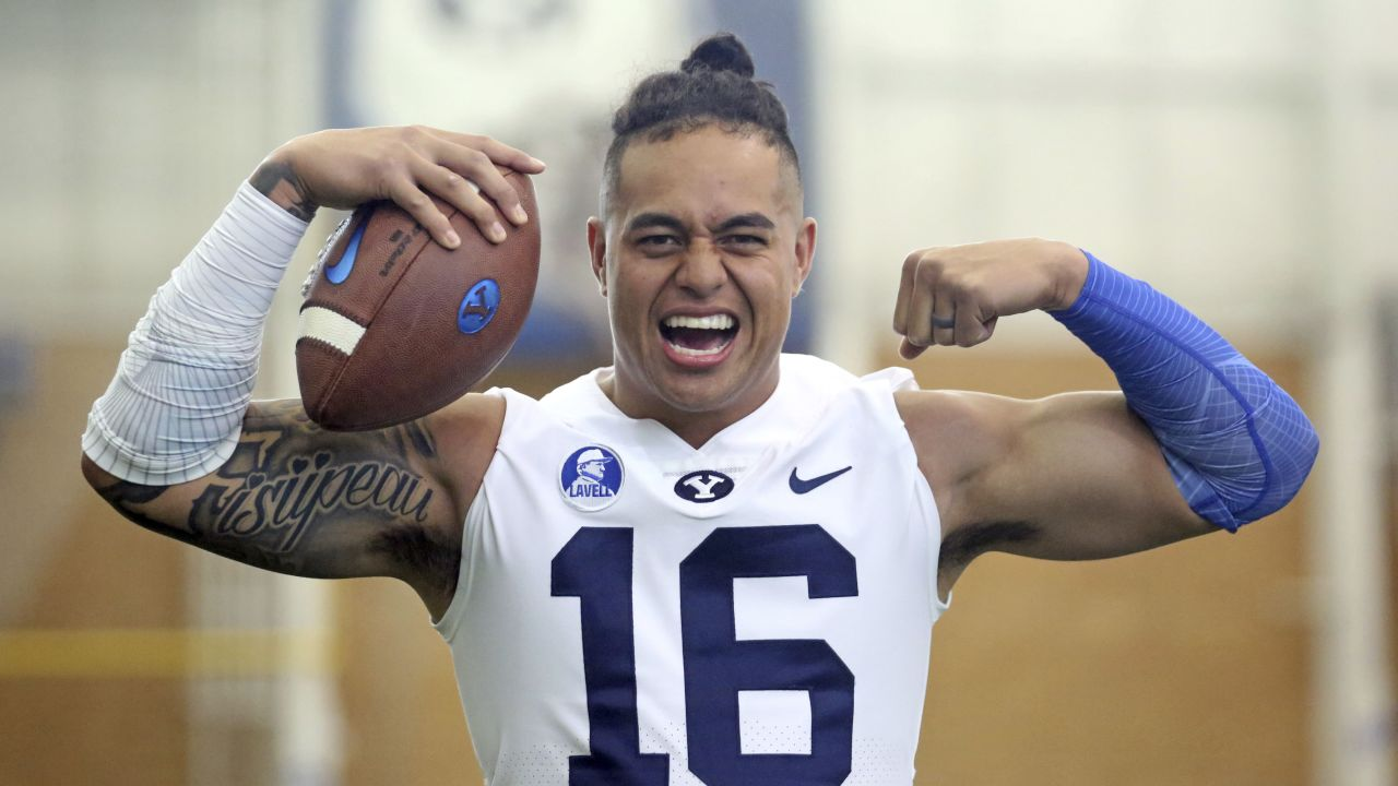 BYU defensive lineman Sione Takitaki poses for photographs during team photo day Wednesday, Aug. 2, 2017, in Provo, Utah. Takitaki hasn't played in a game since October 2015 due to off-field issues, but the junior is back with the Cougars and eager to make up for lost time. (AP Photo/Rick Bowmer)