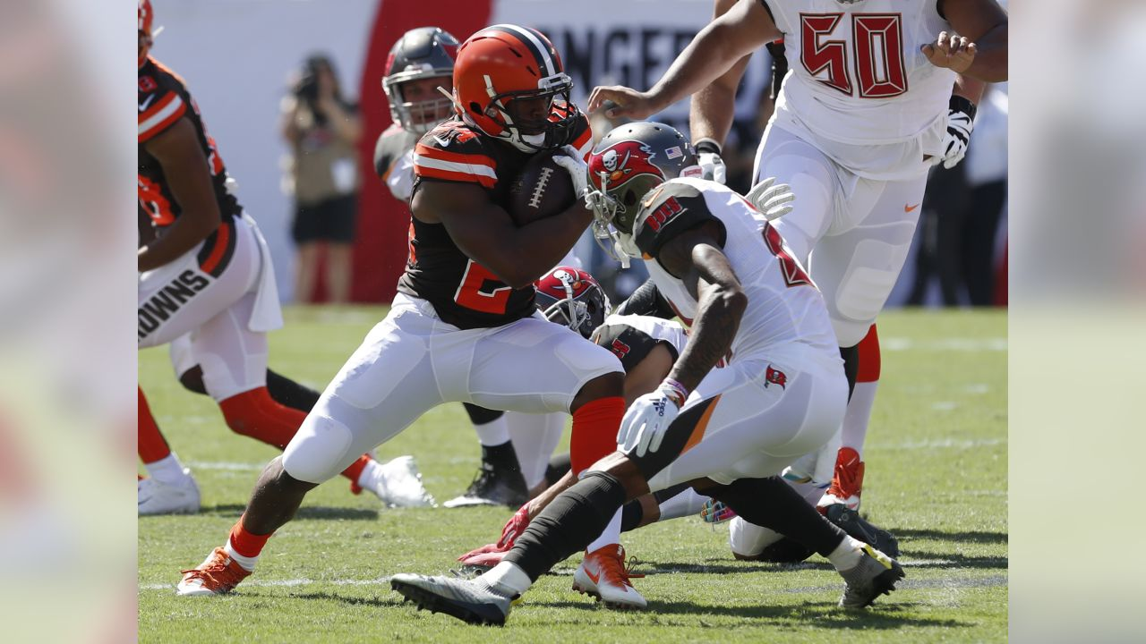 Cleveland Browns running back Nick Chubb (24) cuts in front of Tampa Bay Buccaneers strong safety Justin Evans (21) during the first half of an NFL football game Sunday, Oct. 21, 2018, in Tampa, Fla. (AP Photo/Mark LoMoglio)