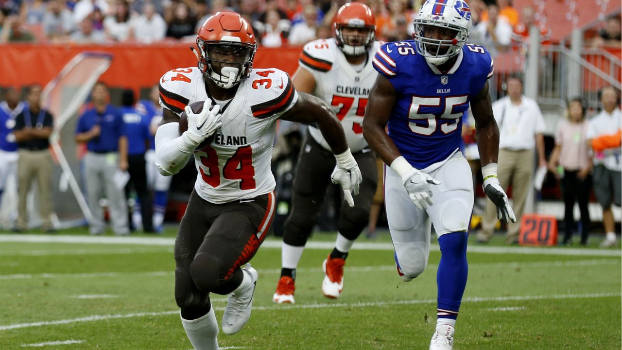 Cleveland Browns running back Carlos Hyde (34) rushes for a 4-yard touchdown during the first half of an NFL football preseason game against the Buffalo Bills, Friday, Aug. 17, 2018, in Cleveland. (AP Photo/Ron Schwane)
