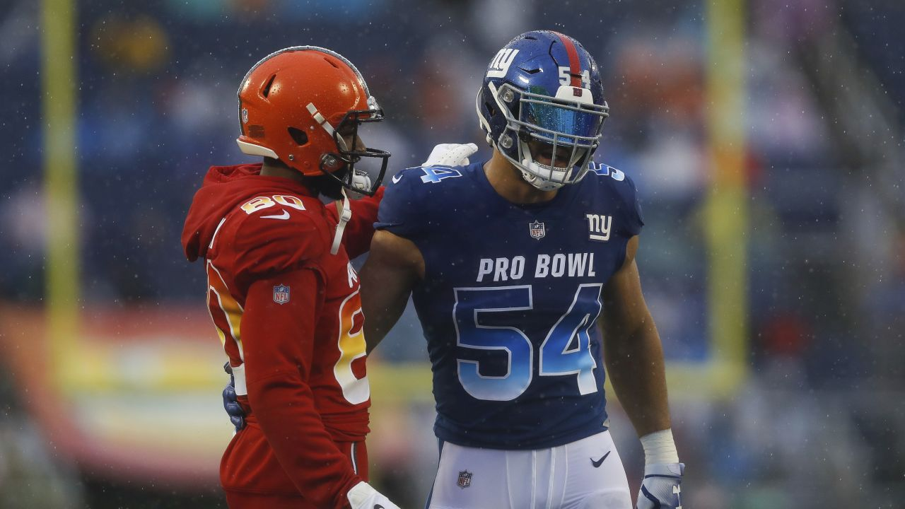 Cleveland Browns wide receiver Jarvis Landry (80) talks with New York Giants outside linebacker Olivier Vernon (54) during an NFL Pro Bowl football game on Sunday, Jan. 27, 2019 in Orlando, Fla. The AFC team won 26-7. (Aaron M. Sprecher via AP)