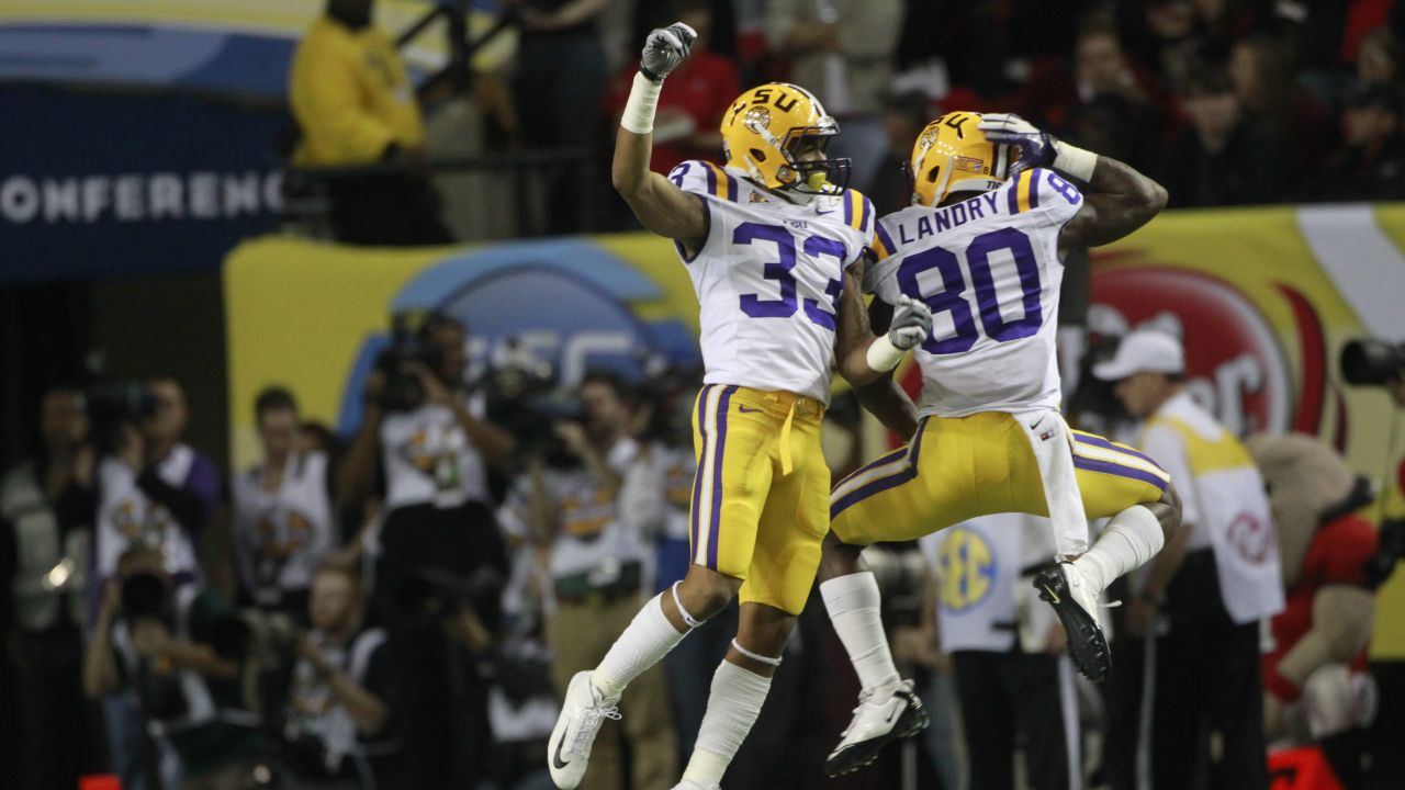 LSU wide receiver Odell Beckham (33) and Jarvis Landry(80) react to an LSU touchdown during the second half of the Southeastern Conference championship NCAA college football game against Georgia, Saturday, Dec. 3, 2011, in Atlanta. LSU won 42-10. (AP Photo/John Bazemore)