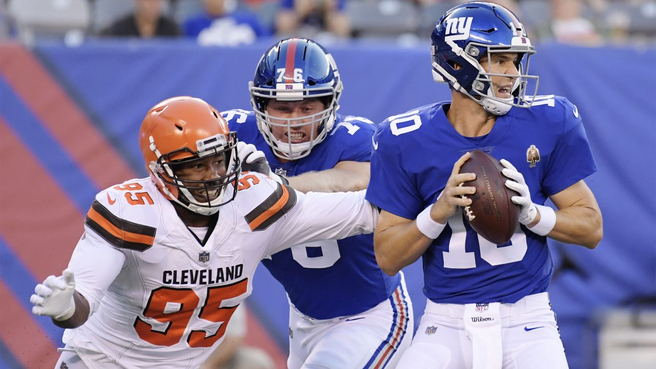 Cleveland Browns defensive end Myles Garrett (95) rushes New York Giants' Eli Manning (10) during the first half of a preseason NFL football game Thursday, Aug. 9, 2018, in East Rutherford, N.J. (AP Photo/Bill Kostroun)