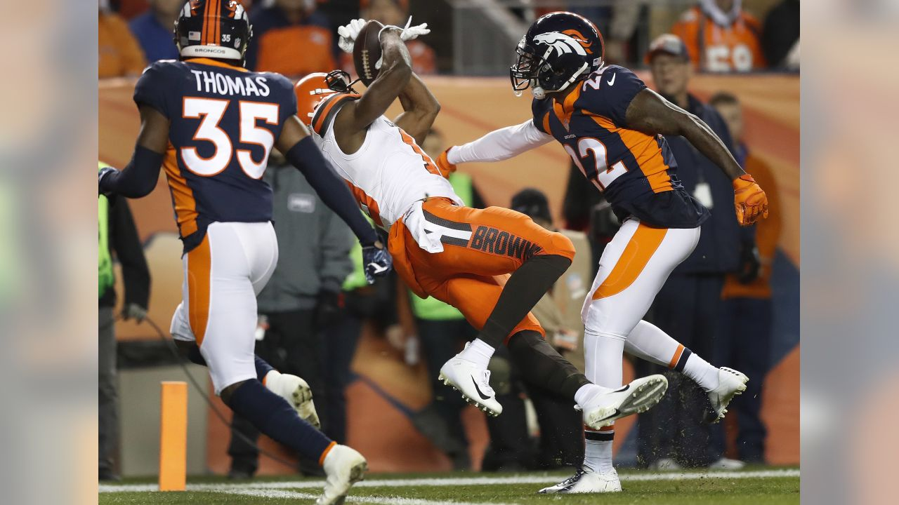 Cleveland Browns wide receiver Breshad Perriman pulls in a touchdown catch as Denver Broncos defensive back Tramaine Brock, right, defends during the first half of an NFL football game, Saturday, Dec. 15, 2018, in Denver. (AP Photo/Jack Dempsey)