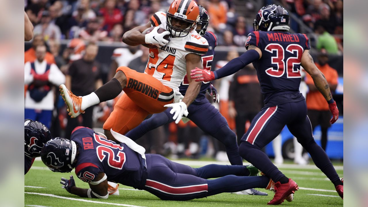 Cleveland Browns running back Nick Chubb (24) is upended by Houston Texans strong safety Justin Reid (20) during the first half of an NFL football game, Sunday, Dec. 2, 2018, in Houston. (AP Photo/Eric Christian Smith)