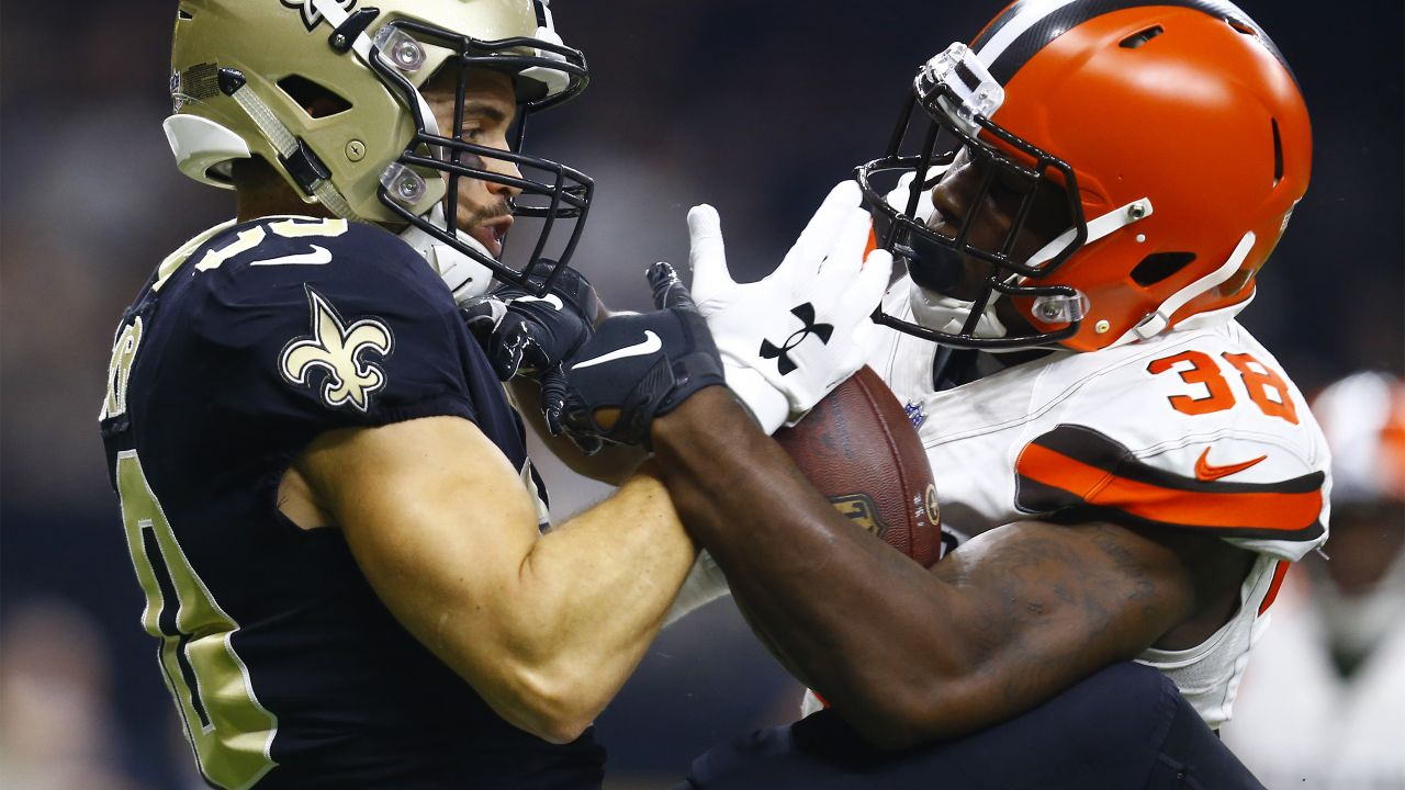 New Orleans Saints wide receiver Austin Carr, left, cannot hold on to the football as Cleveland Browns defensive back T.J. Carrie (38) defends during the first half of an NFL football game in New Orleans, Sunday, Sept. 16, 2018. (AP Photo/Butch Dill)