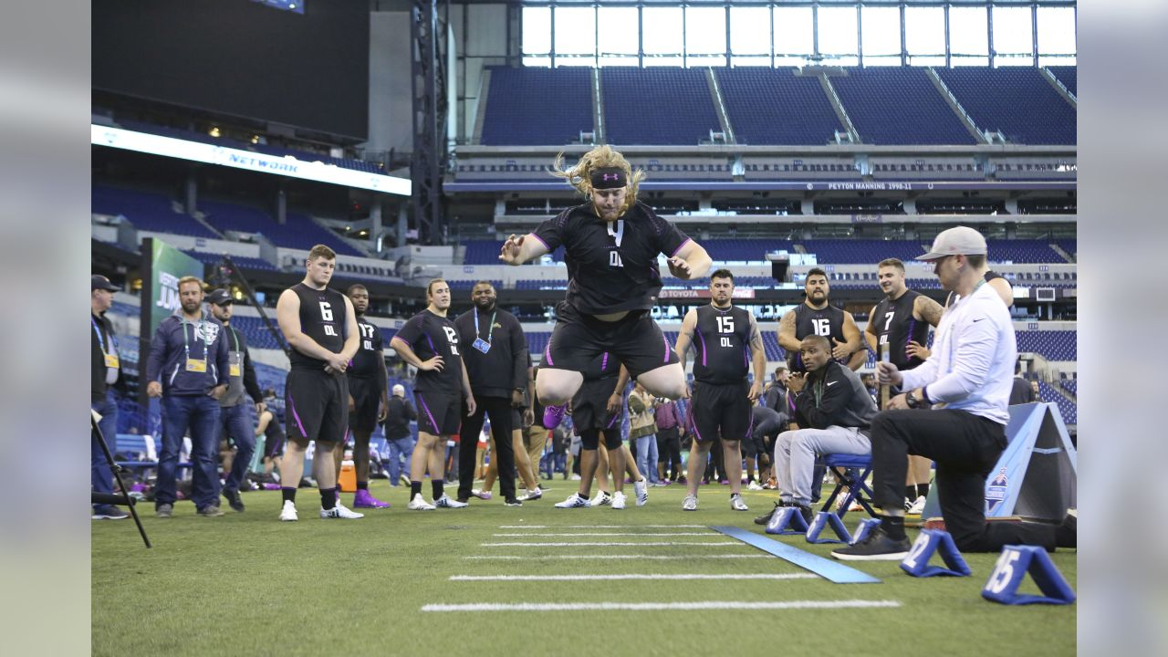 Humboldt State offensive lineman Alex Cappa participates in the Broad Jump at the 2018 NFL Scouting Combine on Friday, March 2, 2018, in Indianapolis. (AP Photo/Gregory Payan)