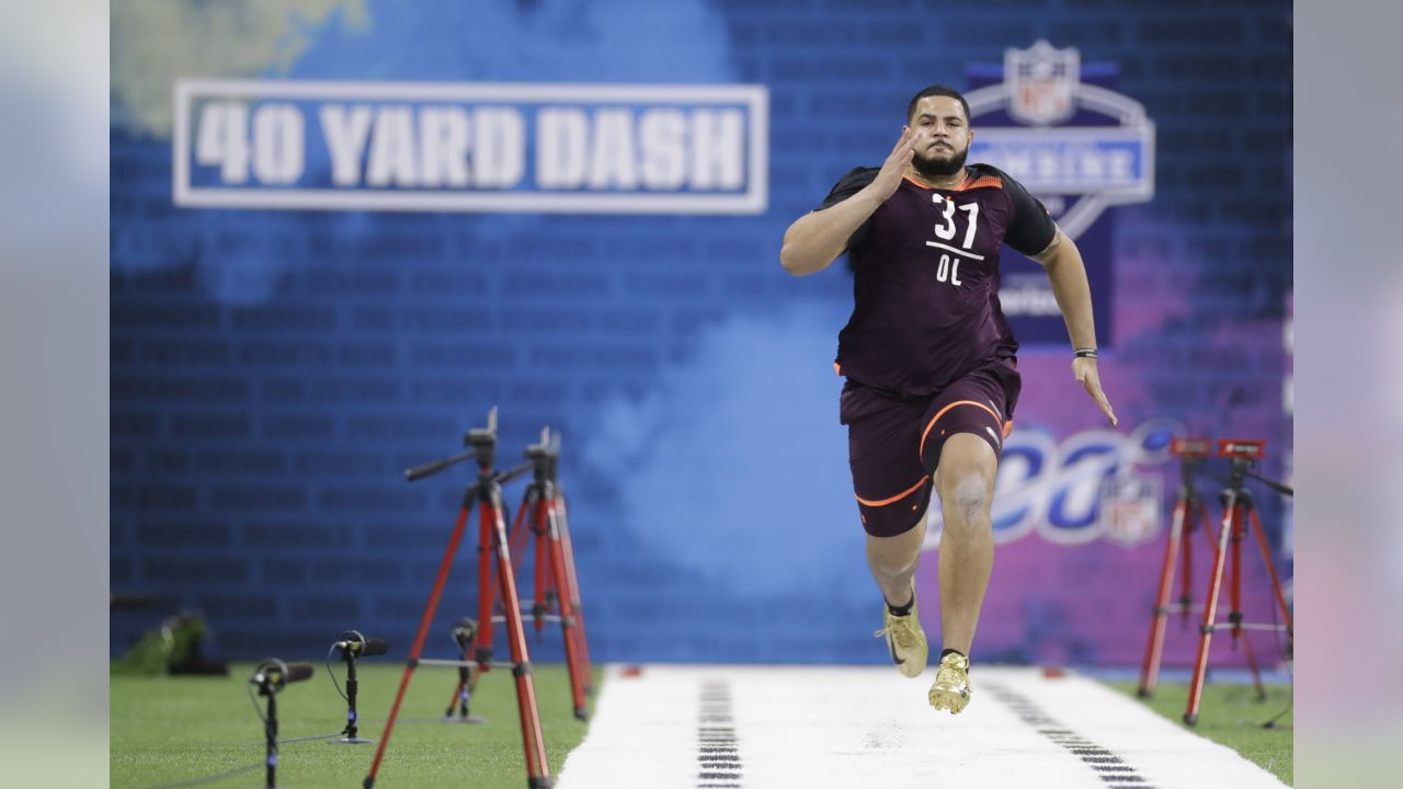Texas A&M offensive lineman Erik McCoy runs the 40-yard dash during the NFL football scouting combine, Friday, March 1, 2019, in Indianapolis. (AP Photo/Darron Cummings)