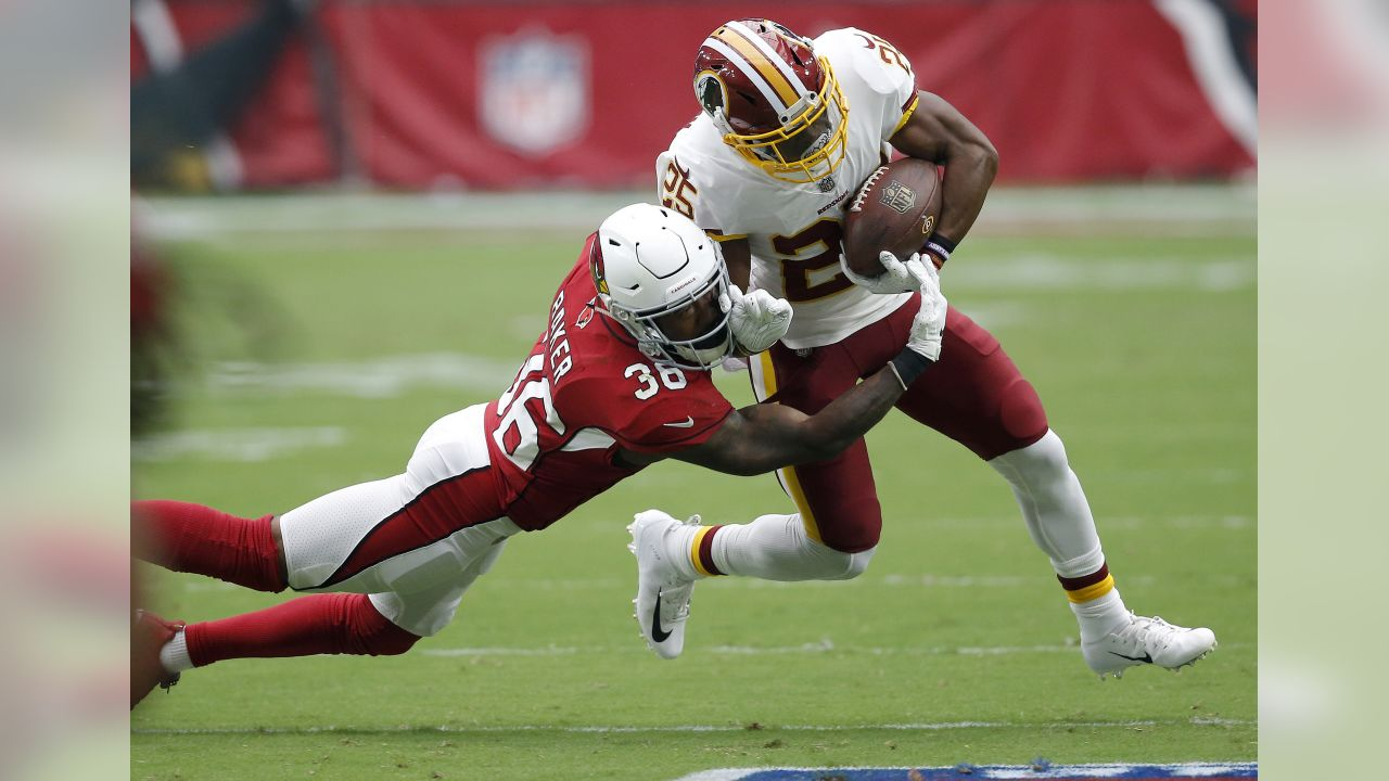 Washington Redskins running back Chris Thompson (25) is hit by Arizona Cardinals defensive back Budda Baker (36) during the first half of an NFL football game, Sunday, Sept. 9, 2018, in Glendale, Ariz.
