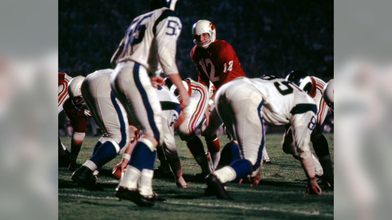 St. Louis Cardinals quarterback Charley Johnson (12) prepares to take the snap from center during an NFL pre-season game against the Los Angeles Rams in Los Angeles, Aug. 27, 1966. The Rams defeated the Cardinals 32-14.