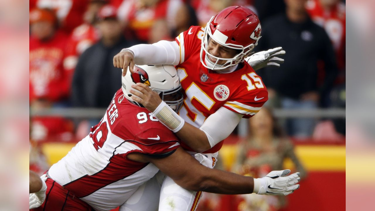 Kansas City Chiefs quarterback Patrick Mahomes (15) is hit by Arizona Cardinals defensive tackle Corey Peters (98) after the throw, during the first half of an NFL football game in Kansas City, Mo., Sunday, Nov. 11, 2018.