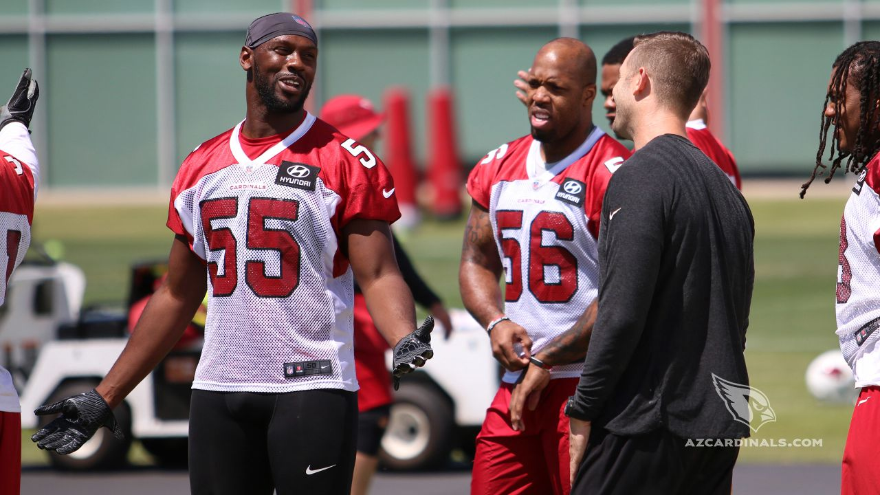 LB Chandler Jones has a laugh with coach Kliff Kingsbury at the outset of practice.