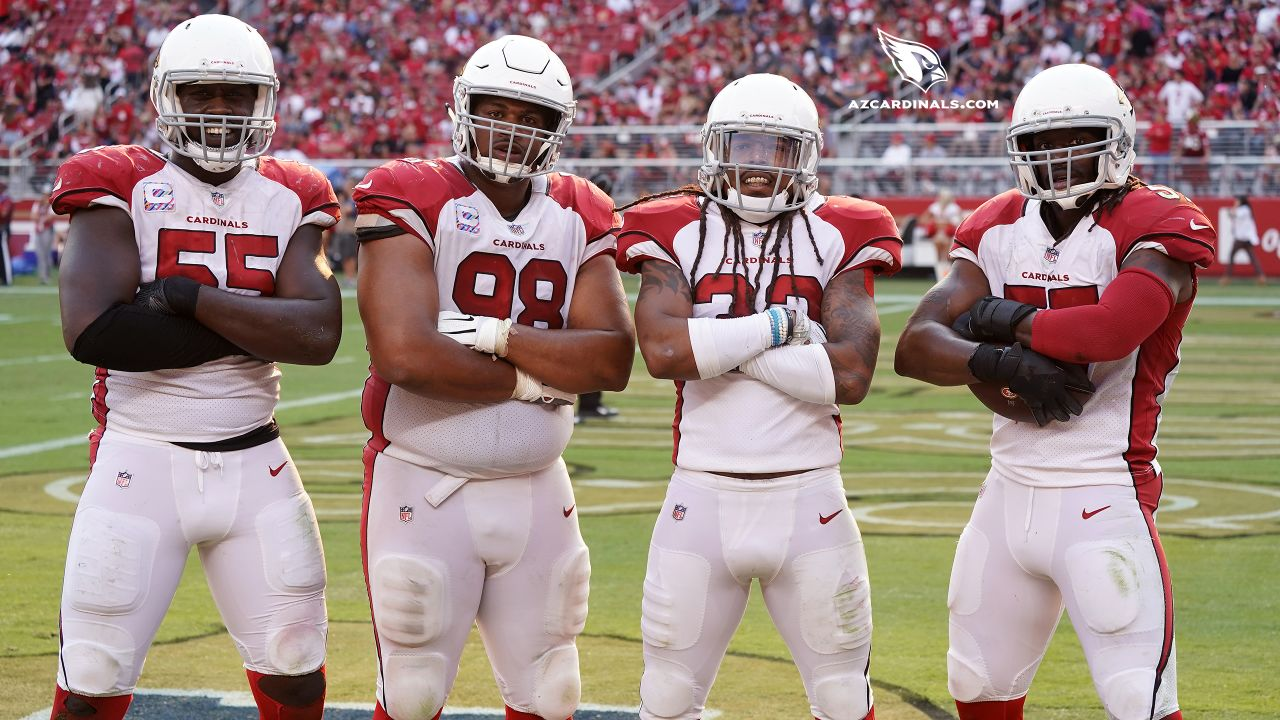 From left: DE Chandler Jones, DT Corey Peters, S Tre Boston and LB Josh Bynes celebrating a defensive touchdown