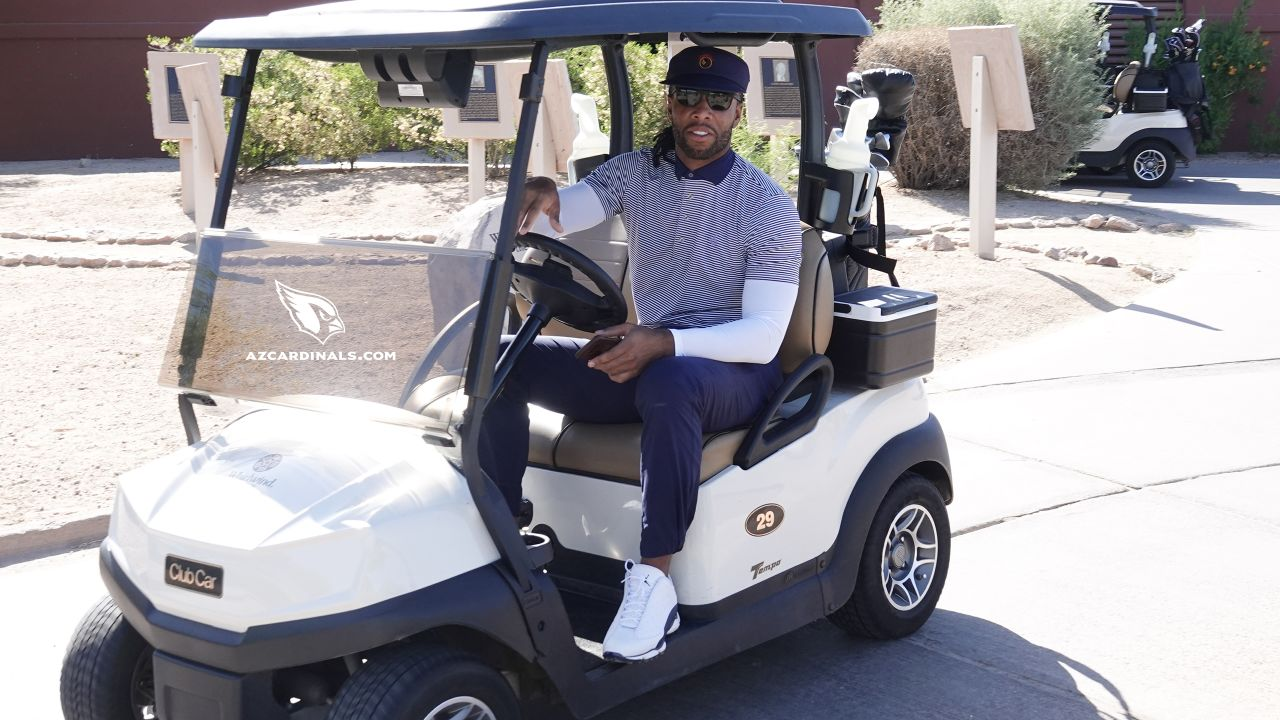 WR Larry Fitzgerald prepares to hit the course
