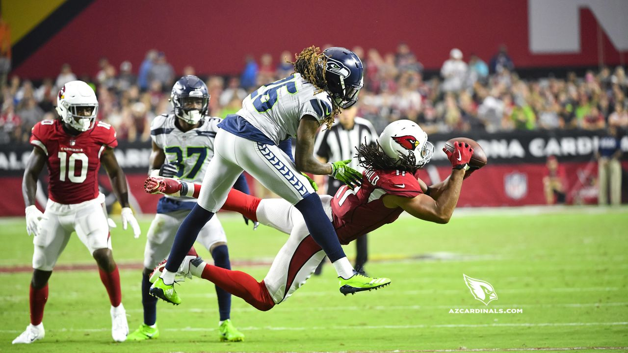 WR Larry Fitzgerald catches a pass against the Seahawks