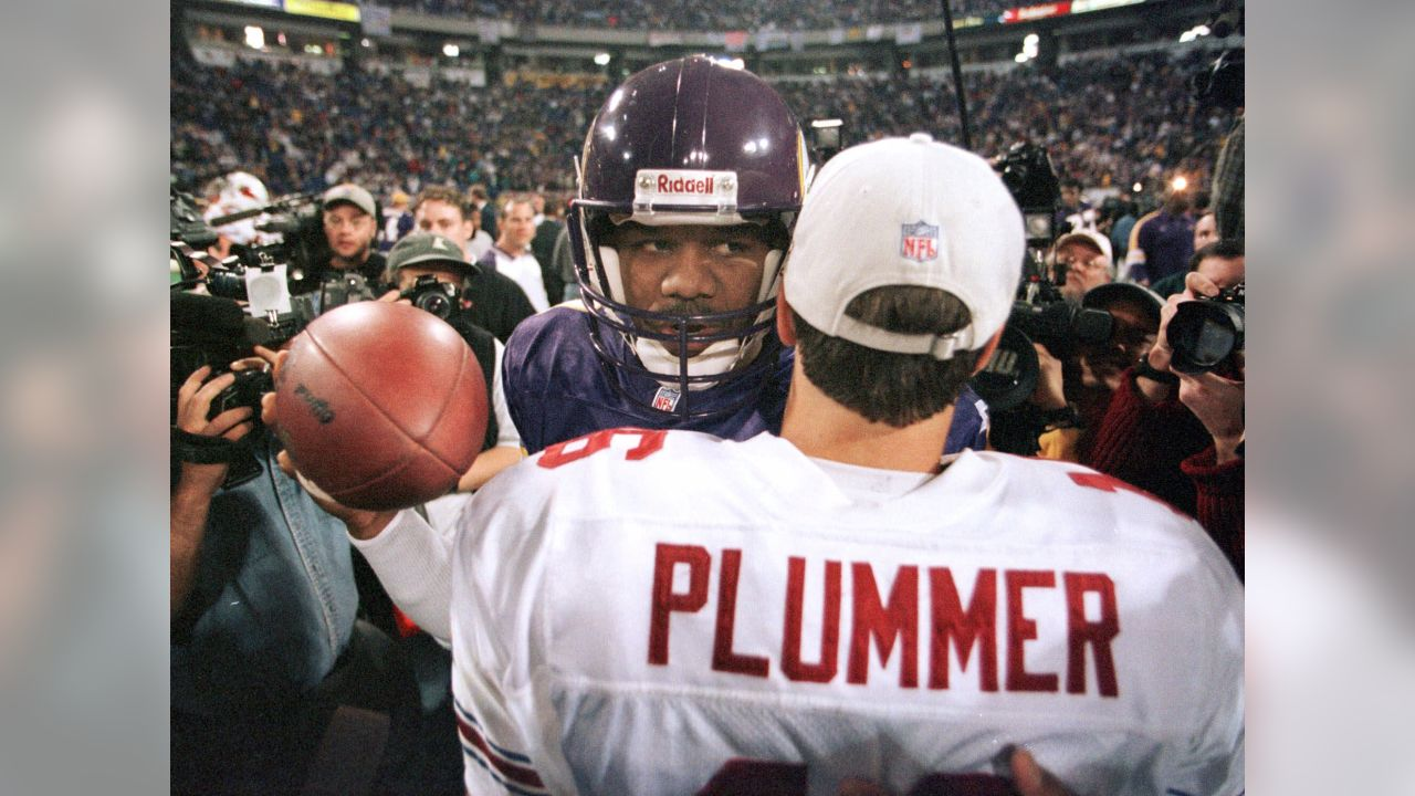 Arizona Cardinals quarterback Jake Plummer gives Minnesota Vikings quarterback Randall Cunningham a hug after the NFC divisional playoff game Sunday, Jan. 10, 1999, in Minneapolis. The Vikings won 41-21.