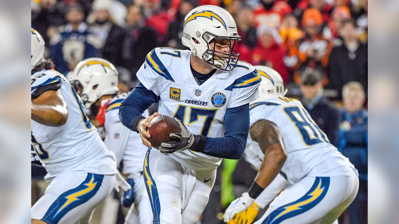 Philip Rivers rolls out of the pocket during the Thursday night matchup against the Kansas City Chiefs at Arrowhead Stadium.