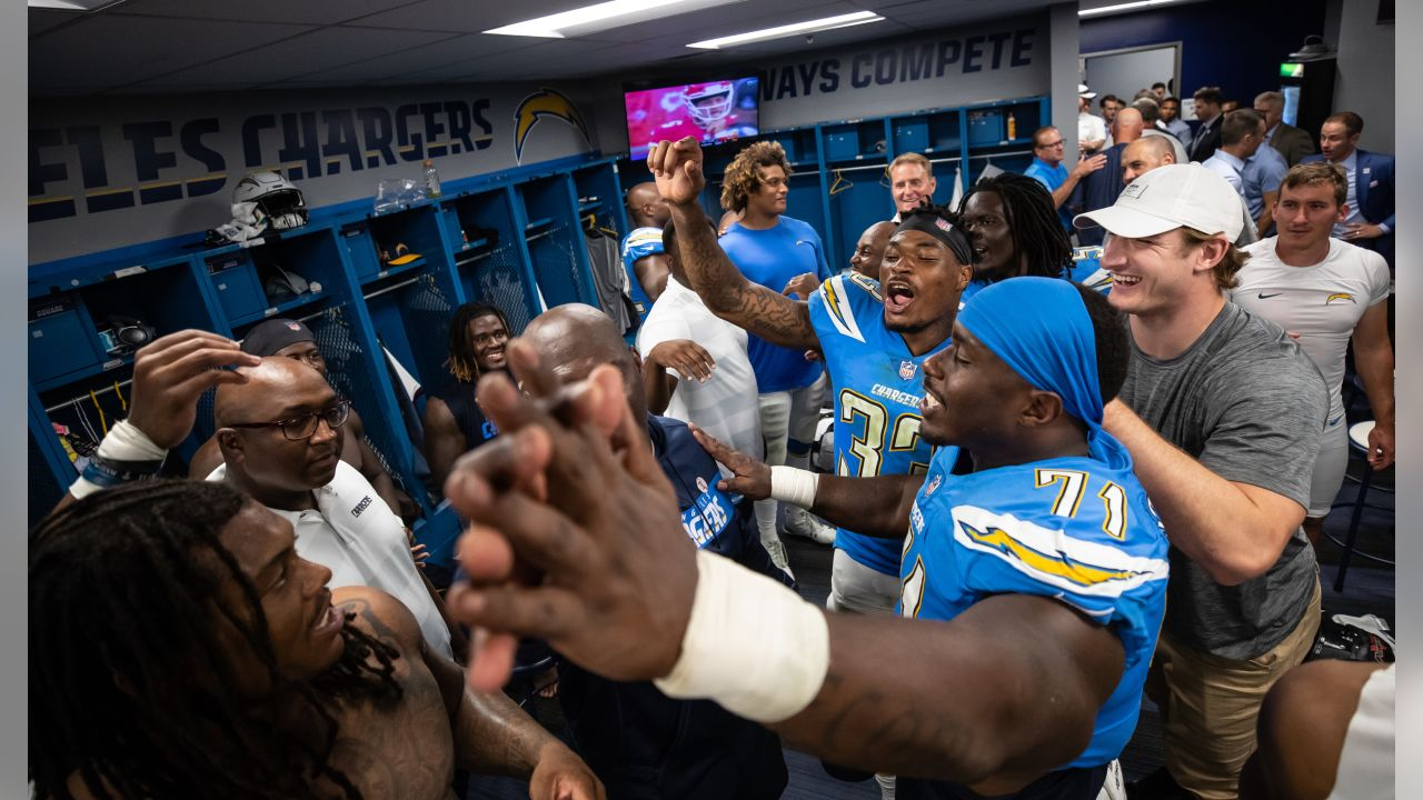 The Bolts celebrate their 26-10 victory over the Oakland Raiders in the locker room postgame.