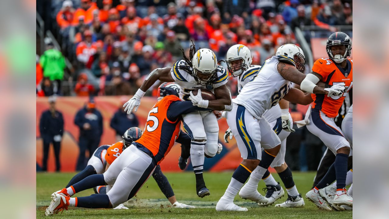Melvin Gordon runs through defenders during the Week 17 contest against the Denver Broncos.