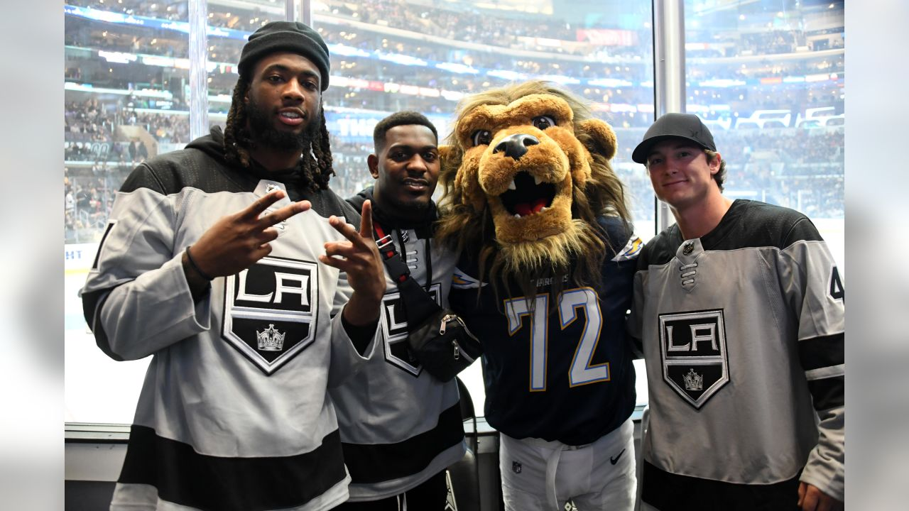 Mike Williams, Desmond King and Michael Badgley pose with Los Angeles Kings mascot Bailey during the Winnipeg Jets vs. Kings game on December 18, 2018 at STAPLES Center.