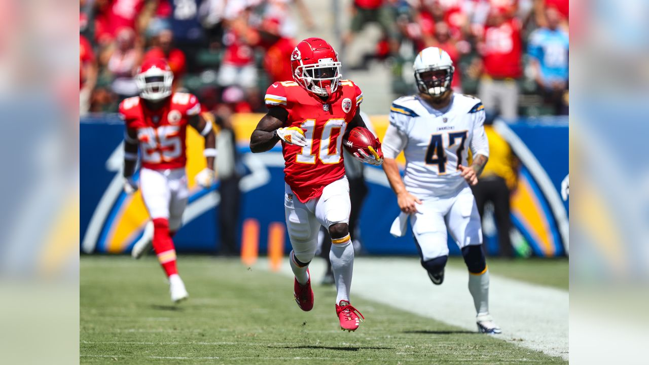 Kansas City Chiefs wide receiver Tyreek Hill (10) runs back punt 91 yards on his first touch of the season