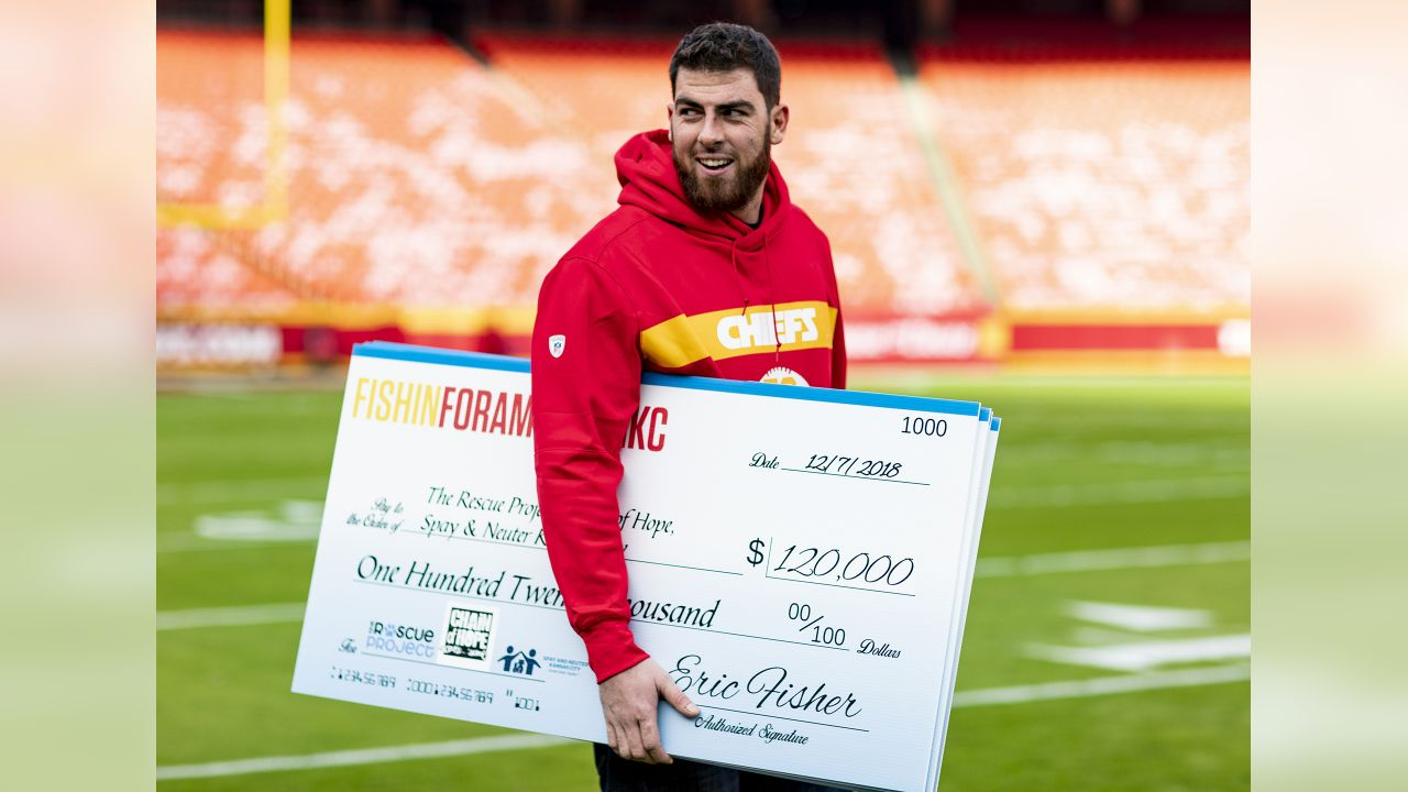 Representatives from Chain of Hope, The Rescue Project and Spay and Neuter Kansas City, came to Arrowhead to meet Chiefs' offensive tackle and pet lover Eric Fisher, who came prepared to assist a cause that he cares dearly about. It was the culmination of a season-long effort that raised $60,000 online – exceeding the original goal by $10,000 – that was then matched by Fisher for a grand total of $120,000 and split evenly between the three organizations on Friday