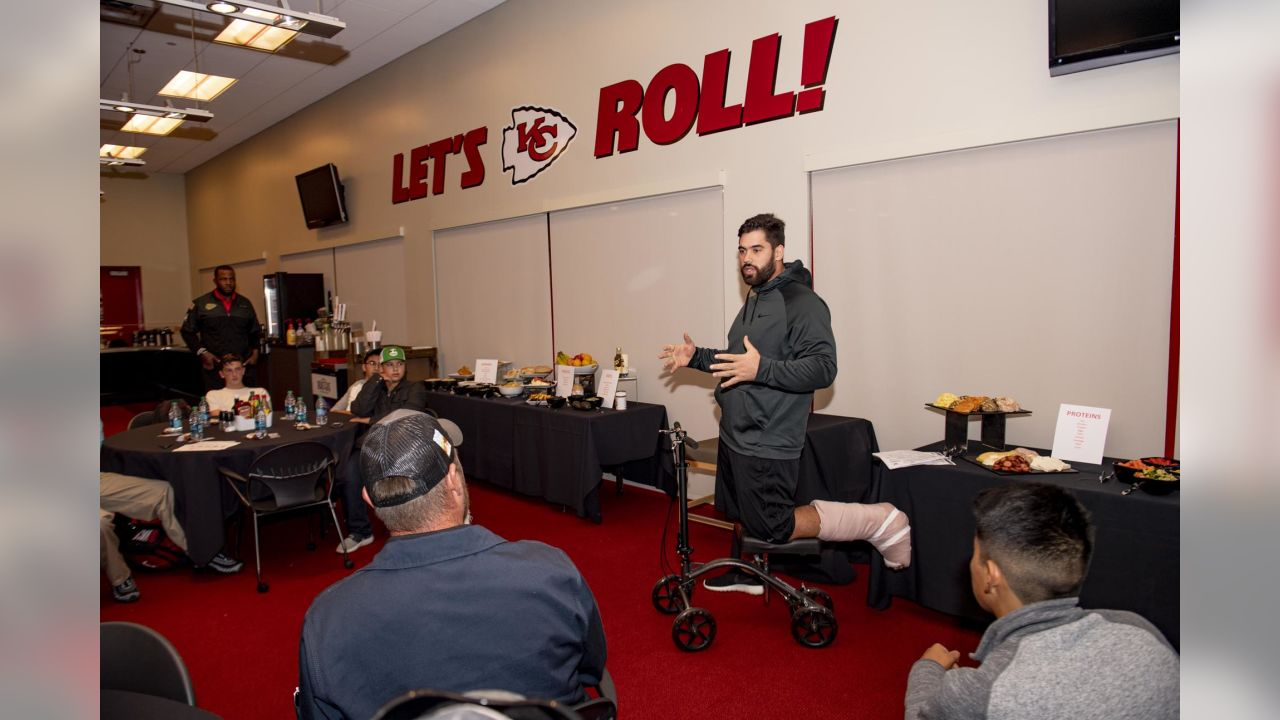 """Laurent Duvernay-Tardif, along with the help of his teammates, explains the basics of healthy living and nutrition to a group of 20 young men from BoysGrow on Monday afternoon. The player-led initiative marked the second installment of the players' """"4th Quarter Program"""" which seeks to address social justice areas of particular importance to the players themselves."""