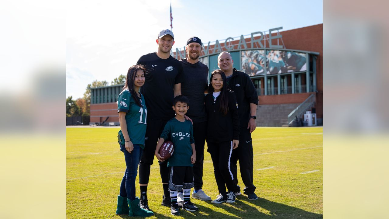 Nick Foles and Nate Sudfeld with Eagles Radiothon winner Brandon and his family