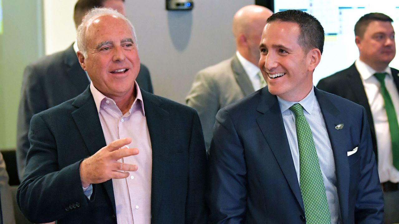 Eagles Chairman and CEO Jeffrey Lurie and Executive Vice President of Football Operations Howie Roseman react inside the draft room during Round 1 of the NFL Draft