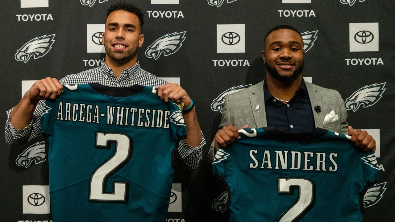 J.J. Arcega-Whiteside and Miles Sanders hold up jerseys at their introductory press conference