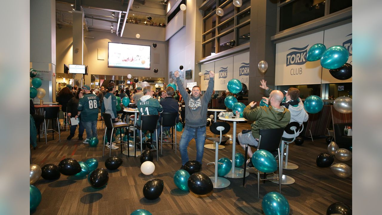 A group of excited fans at the Eagles Draft Party