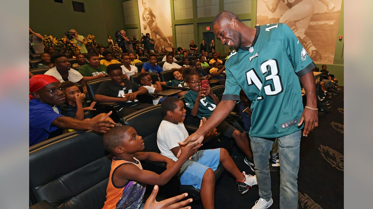 WR Nelson Agholor greets some youth football players
