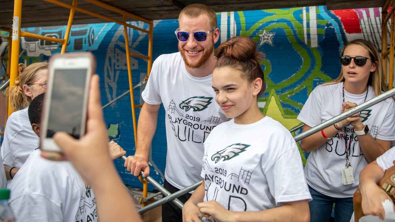 QB Carson Wentz with one of the students
