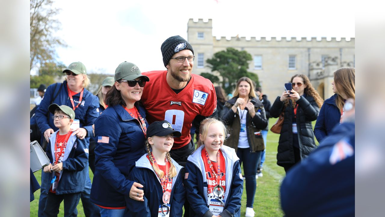The Philadelphia Eagles visit with families of America's and England's fallen heroes on October 27 in London