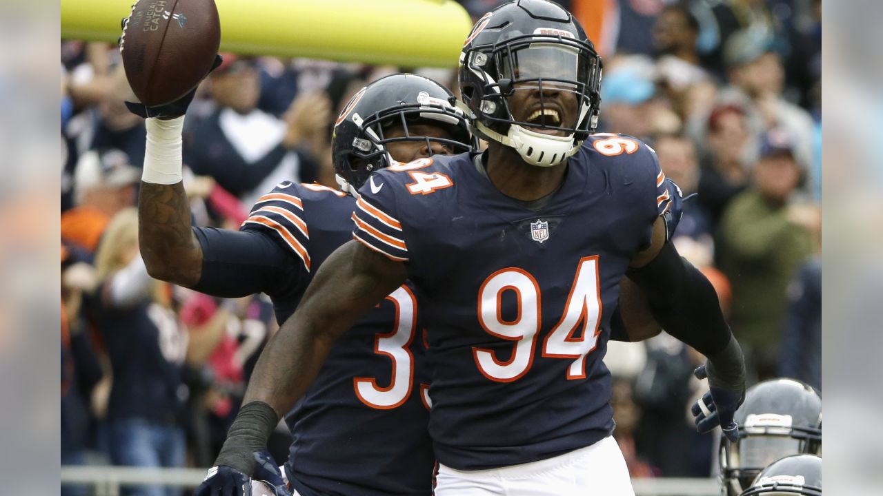 Chicago Bears safety Eddie Jackson, rear, and teammate linebacker Leonard Floyd (94) celebrate the 76-yard interception that was returned for a touchdown by Jackson during the first half of an NFL football game against the Carolina Panthers, Sunday, Oct. 22, 2017, in Chicago. (AP Photo/Nam Y. Huh)