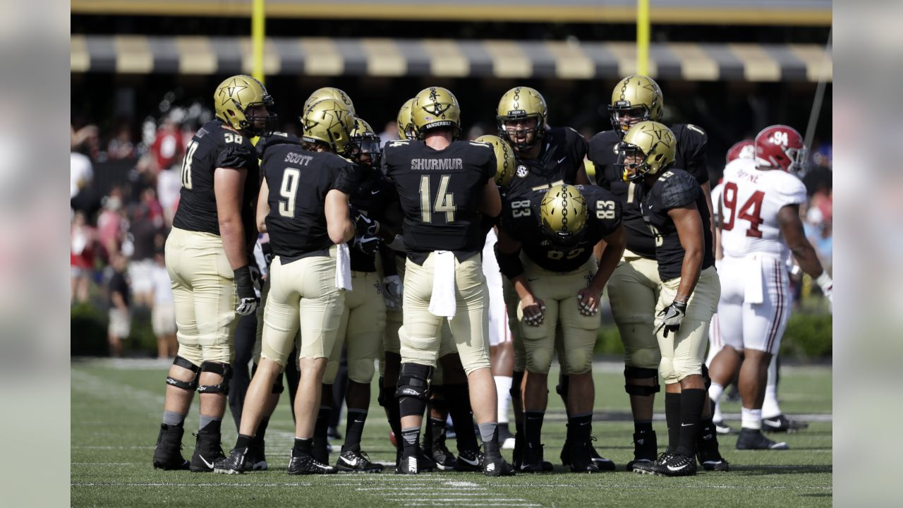 Vanderbilt quarterback Kyle Shurmur (14) calls a play in the first half of an NCAA college football game against Alabama Saturday, Sept. 23, 2017, in Nashville, Tenn. (AP Photo/Mark Humphrey)