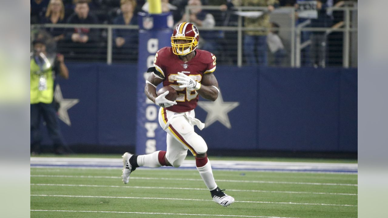 Washington Redskins running back Adrian Peterson (26) runs against the Dallas Cowboys during the second half of an NFL football game in Arlington, Texas, Thursday, Nov. 22, 2018. (AP Photo/Michael Ainsworth)