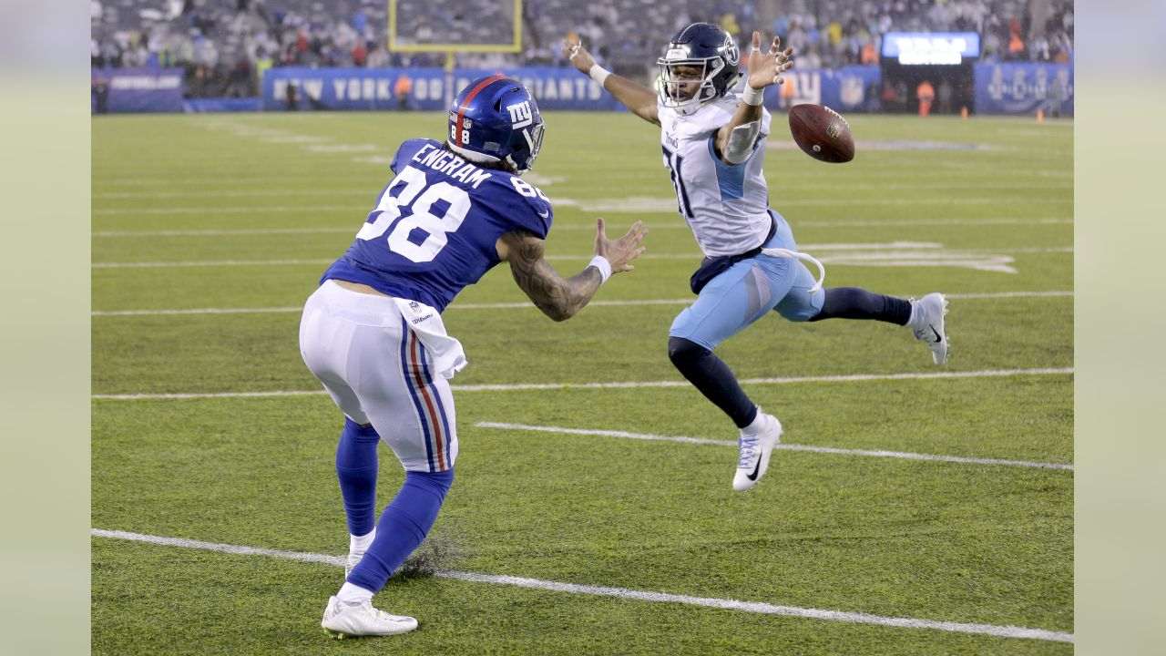 A pass from New York Giants quarterback Eli Manning, not pictured, hits Tennessee Titans free safety Kevin Byard, right, in the back during a an attempt to tight end Evan Engram during in second half of an NFL football game, Sunday, Dec. 16, 2018, in East Rutherford, N.J. The Titans won 17-0. (AP Photo/Seth Wenig)