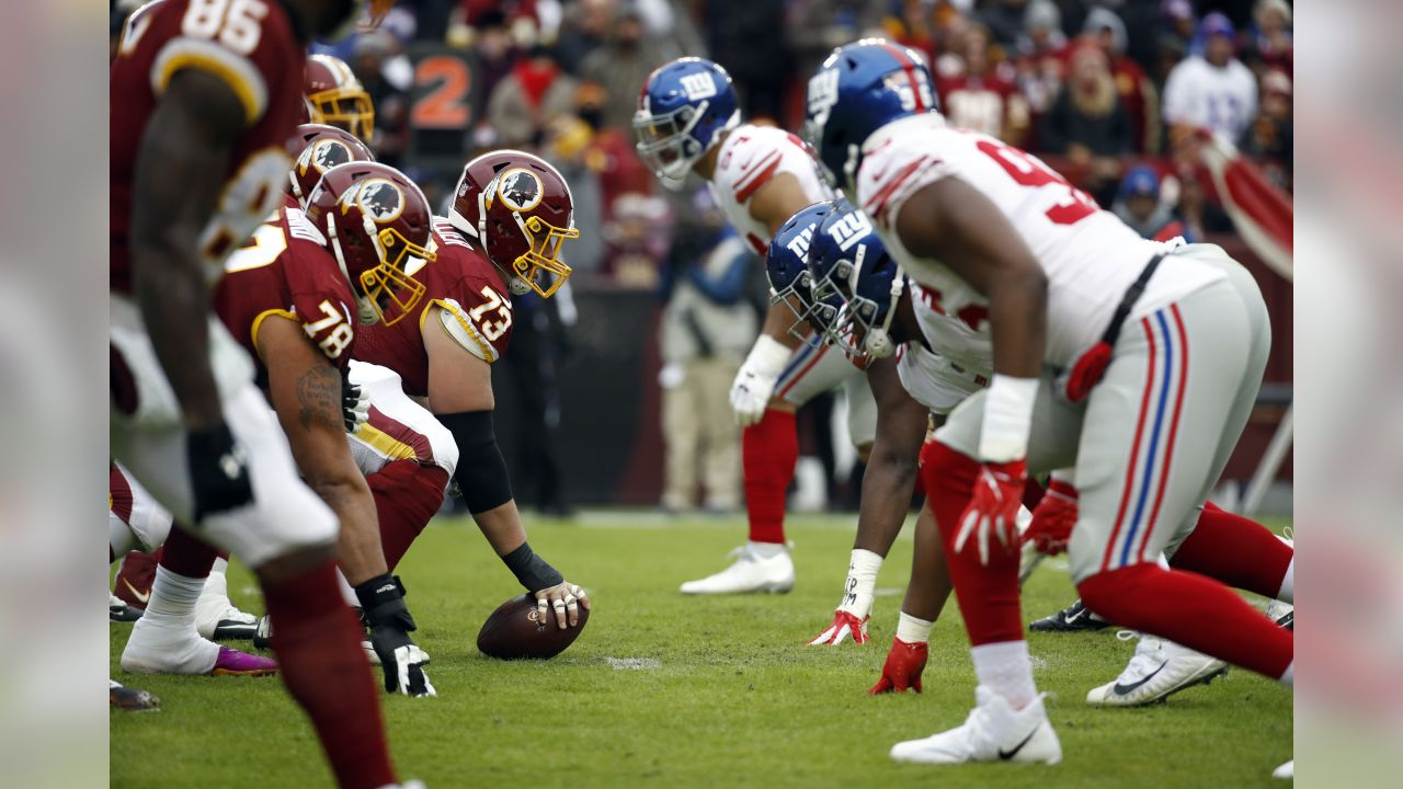 The Washington Redskins and the New York Giants are at the line of scrimmage during the first half of an NFL football game Sunday, Dec. 9, 2018, in Landover, Md. (AP Photo/Patrick Semansky)