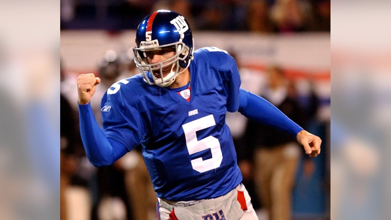 New York Giants quarterback Kerry Collins celebrates after running back Tiki Barber scored a touchdown in the first quarter against the Jacksonville Jaguars Sunday, Nov. 3, 2002, at Giants Stadium in East Rutherford, N.J.    (AP Photo/Bill Kostroun)