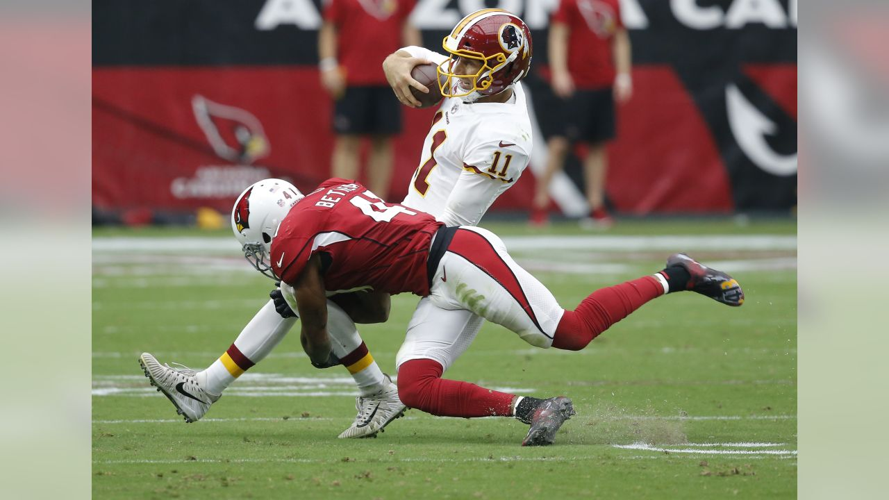 Washington Redskins quarterback Alex Smith (11) is hit by Arizona Cardinals defensive back Antoine Bethea (41) during the first half of an NFL football game, Sunday, Sept. 9, 2018, in Glendale, Ariz. (AP Photo/Ross D. Franklin)