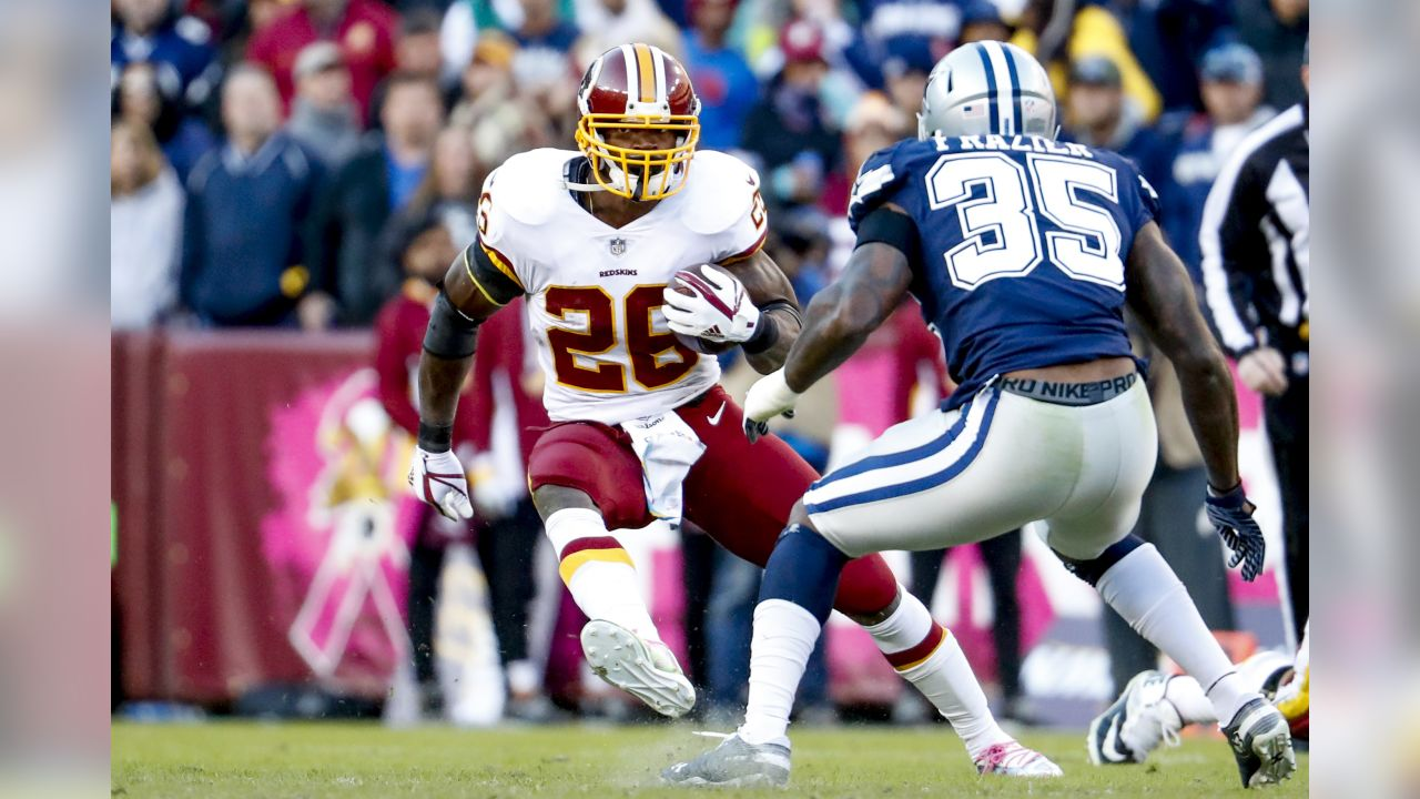 Washington Redskins running back Adrian Peterson (26) cuts away from Dallas Cowboys defensive back Kavon Frazier (35) in the second quarter of an NFL football game, Sunday, Oct. 21, 2018, in Landover, Md. The Redskins defeated the Cowboys 20-17. (AP Photo/Andrew Harnik)