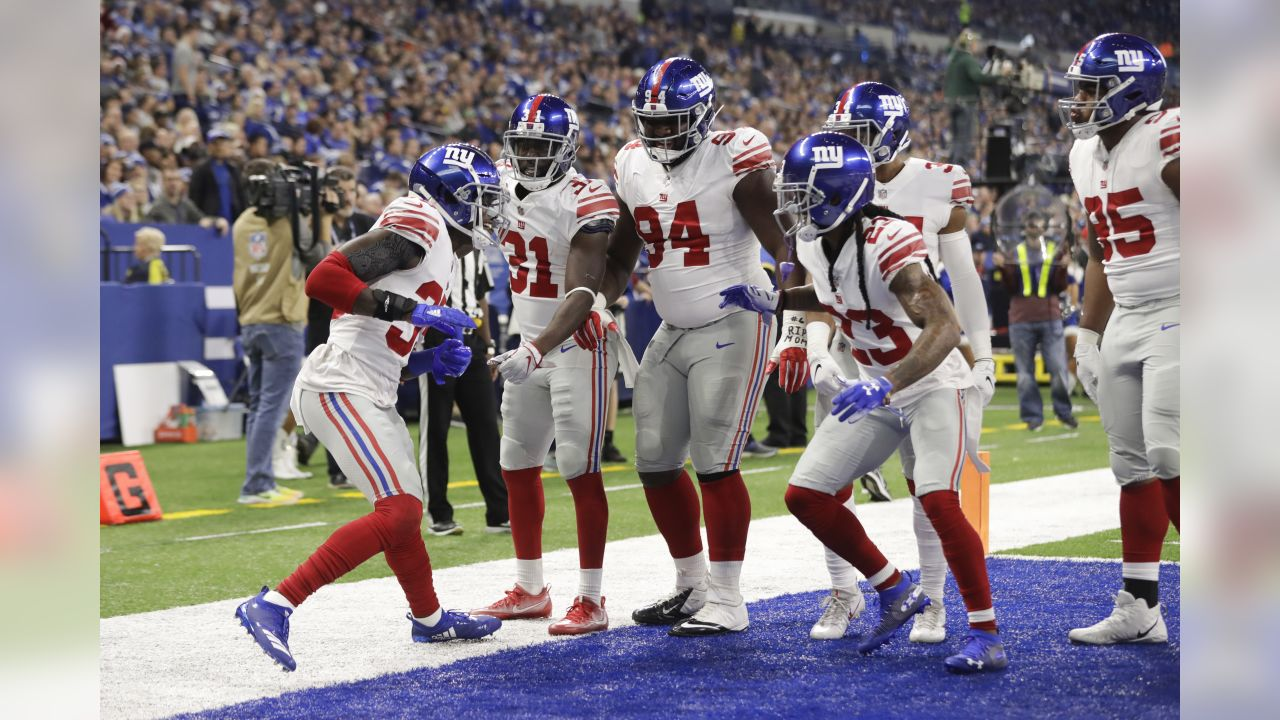 New York Giants free safety Curtis Riley, left, celebrates an interception with teammates against the Indianapolis Colts during the first half of an NFL football game in Indianapolis, Sunday, Dec. 23, 2018. (AP Photo/Darron Cummings)